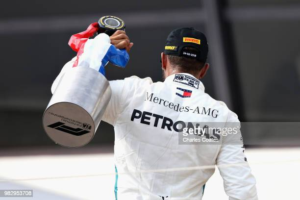 Race winner Lewis Hamilton of Great Britain and Mercedes GP celebrates on the podium during the Formula One Grand Prix of France at Circuit Paul...