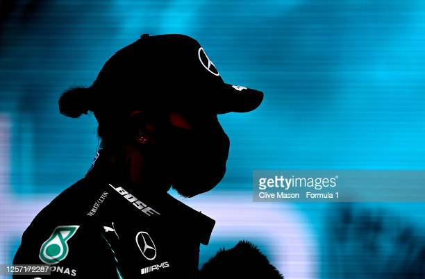 Race winner Lewis Hamilton of Great Britain and Mercedes GP reacts in parc ferme after the Formula One Grand Prix of Hungary at Hungaroring on July...