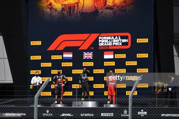 Race winner Lewis Hamilton of Great Britain and Mercedes GP runnerup Max Verstappen of Netherlands and Red Bull Racing and thirdplaced Charles...