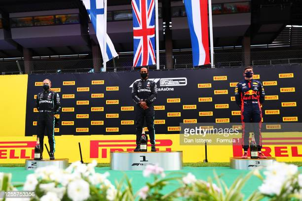 Race winner Lewis Hamilton of Great Britain and Mercedes GP second placed Valtteri Bottas of Finland and Mercedes GP and third placed Max Verstappen...