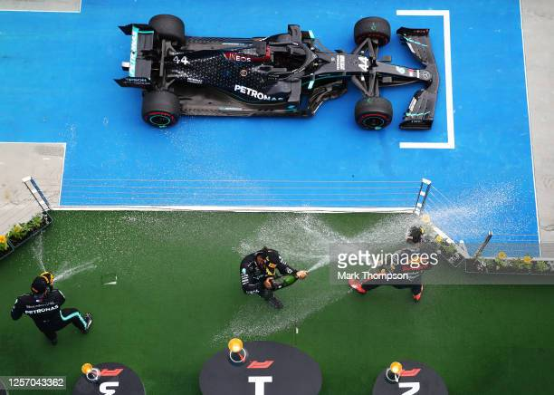 Race winner Lewis Hamilton of Great Britain and Mercedes GP, second placed Max Verstappen of Netherlands and Red Bull Racing and third placed...