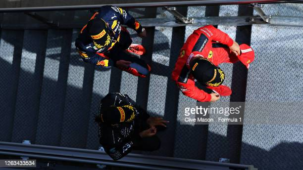 Race winner Lewis Hamilton of Great Britain and Mercedes GP second placed Max Verstappen of Netherlands and Red Bull Racing and third placed Charles...