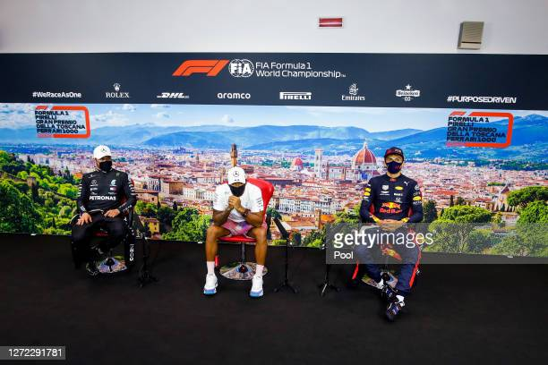 Race winner Lewis Hamilton of Great Britain and Mercedes GP second placed Valtteri Bottas of Finland and Mercedes GP and third placed Alexander Albon...