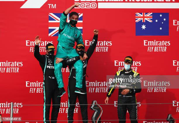 Race winner Lewis Hamilton of Great Britain and Mercedes GP, second placed Valtteri Bottas of Finland and Mercedes GP and Mercedes GP mechanic Leo...