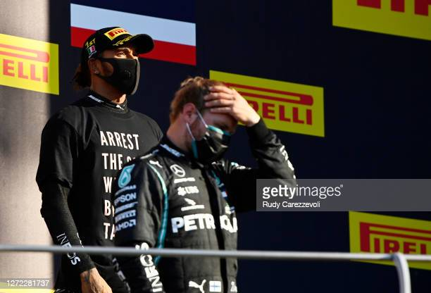 Race winner Lewis Hamilton of Great Britain and Mercedes GP stands on the podium during the F1 Grand Prix of Tuscany at Mugello Circuit on September...