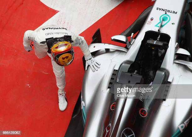 Race winner Lewis Hamilton of Great Britain and Mercedes GP strokes his car in parc ferme during the Formula One Grand Prix of China at Shanghai...