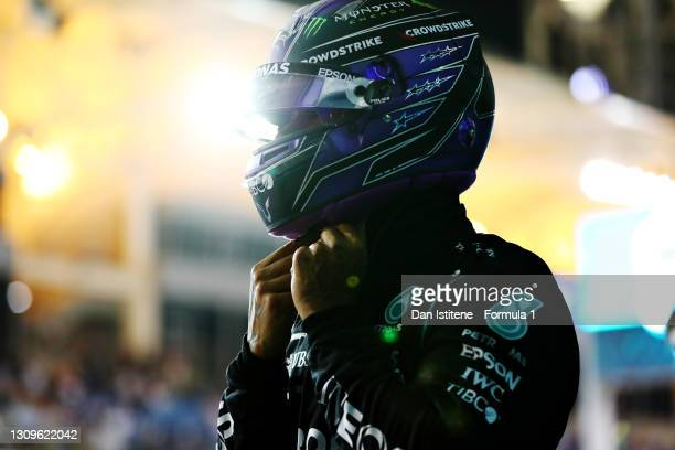 Race winner Lewis Hamilton of Great Britain and Mercedes GP takes off his helmet in parc ferme during the F1 Grand Prix of Bahrain at Bahrain...