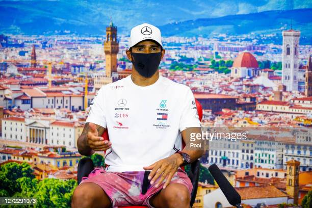 Race winner Lewis Hamilton of Great Britain and Mercedes GP talks in a press conference after the F1 Grand Prix of Tuscany at Mugello Circuit on...