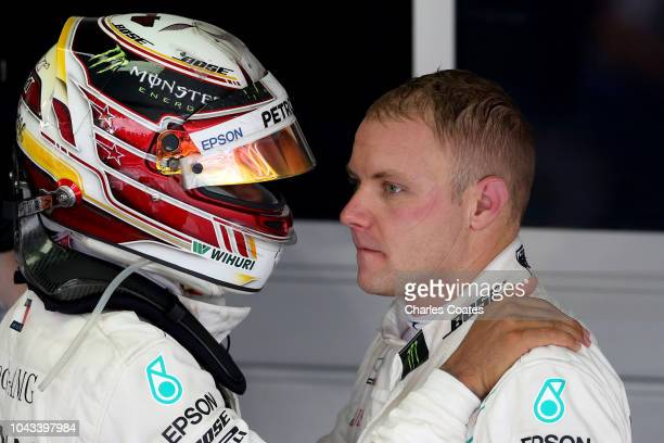 Race winner Lewis Hamilton of Great Britain and Mercedes GP thanks second placed Valtteri Bottas of Finland and Mercedes GP in parc ferme during the...