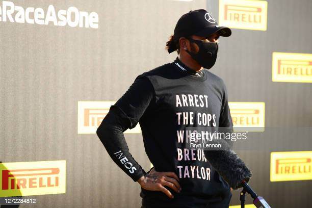 Race winner Lewis Hamilton of Great Britain and Mercedes GP wears a shirt in tribute to the late Breonna Taylor as he talks to the media in parc...