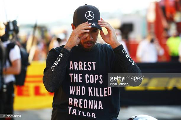 Race winner Lewis Hamilton of Great Britain and Mercedes GP wears a shirt in tribute to the late Breonna Taylor in parc ferme during the F1 Grand...