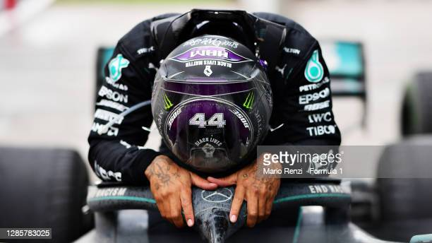 Race winner Lewis Hamilton of Great Britain and Mercedes GP celebrates winning a 7th F1 World Drivers Championship in parc ferme during the F1 Grand...