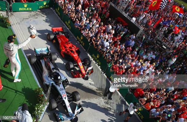 Race winner Lewis Hamilton of Great Britain and Mercedes GP celebrates with his trophy on the podium during the Formula One Grand Prix of Hungary at...