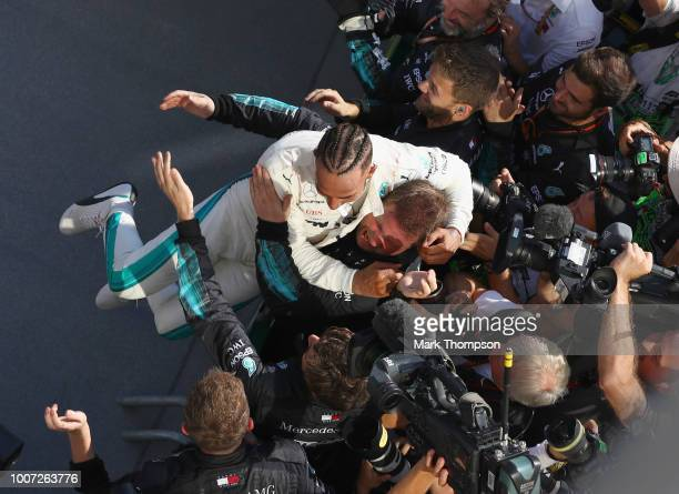 Race winner Lewis Hamilton of Great Britain and Mercedes GP celebrates with his team in parc ferme during the Formula One Grand Prix of Hungary at...