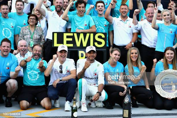Race winner Lewis Hamilton of Great Britain and Mercedes GP celebrates with his team after the Formula One Grand Prix of Hungary at Hungaroring on...