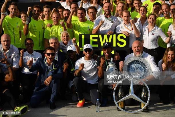 Race winner Lewis Hamilton of Great Britain and Mercedes GP celebrates with his team after the F1 Grand Prix of Hungary at Hungaroring on August 04...