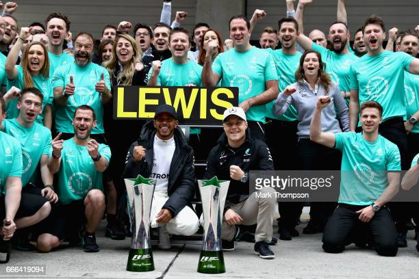 Race winner Lewis Hamilton of Great Britain and Mercedes GP celebrates with his team during the Formula One Grand Prix of China at Shanghai...