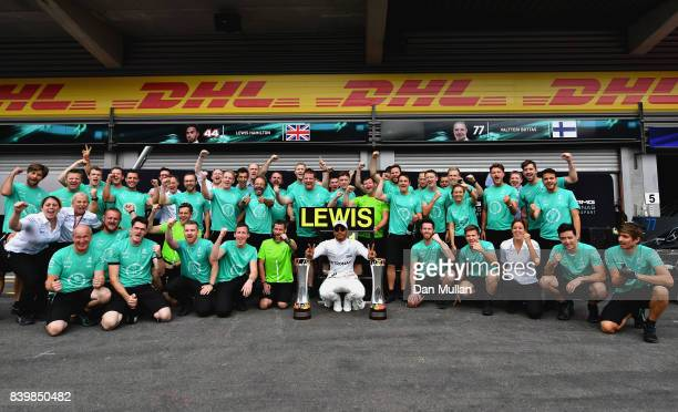 Race winner Lewis Hamilton of Great Britain and Mercedes GP celebrates with his team during the Formula One Grand Prix of Belgium at Circuit de...