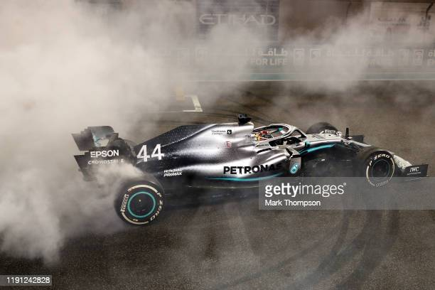 Race winner Lewis Hamilton of Great Britain and Mercedes GP celebrates with donuts on track during the F1 Grand Prix of Abu Dhabi at Yas Marina...