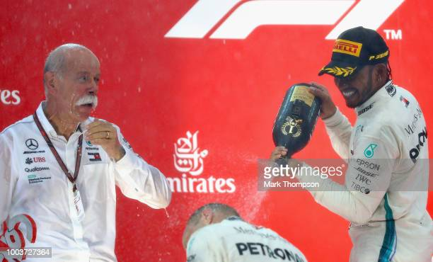 Race winner Lewis Hamilton of Great Britain and Mercedes GP celebrates with second placed Valtteri Bottas of Finland and Mercedes GP and Head of...