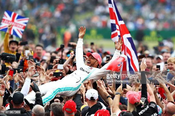 Race winner Lewis Hamilton of Great Britain and Mercedes GP celebrates with fans after the F1 Grand Prix of Great Britain at Silverstone on July 14,...