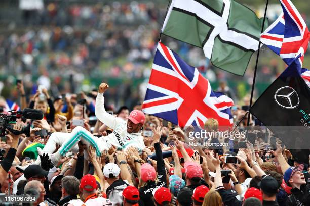 Race winner Lewis Hamilton of Great Britain and Mercedes GP celebrates with fans after the F1 Grand Prix of Great Britain at Silverstone on July 14...