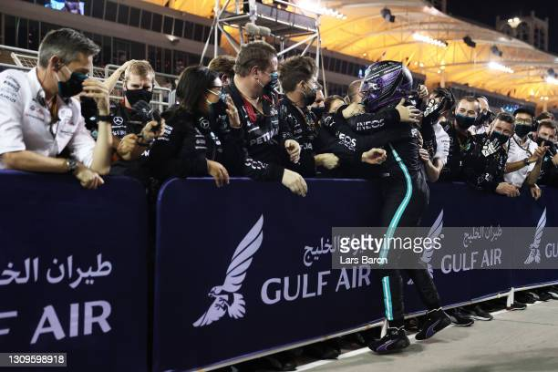Race winner Lewis Hamilton of Great Britain and Mercedes GP celebrates with team members in parc ferme during the F1 Grand Prix of Bahrain at Bahrain...