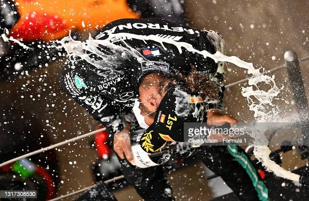 Race winner Lewis Hamilton of Great Britain and Mercedes GP celebrates with sparkling wine on the podium during the F1 Grand Prix of Spain at Circuit...