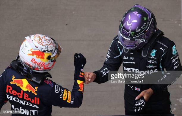 Race winner Lewis Hamilton of Great Britain and Mercedes GP celebrates with second placed Max Verstappen of Netherlands and Red Bull Racing in parc...