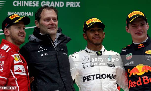 Race winner Lewis Hamilton of Great Britain and Mercedes GP with second placed finisher Sebastian Vettel of Germany and Ferrari and third placed...