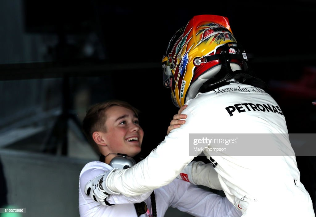 Race winner Lewis Hamilton of Great Britain and Mercedes GP celebrates with Billy Monger in parc ferme during the Formula One Grand Prix of Great Britain at Silverstone on July 16, 2017 in Northampton, England.