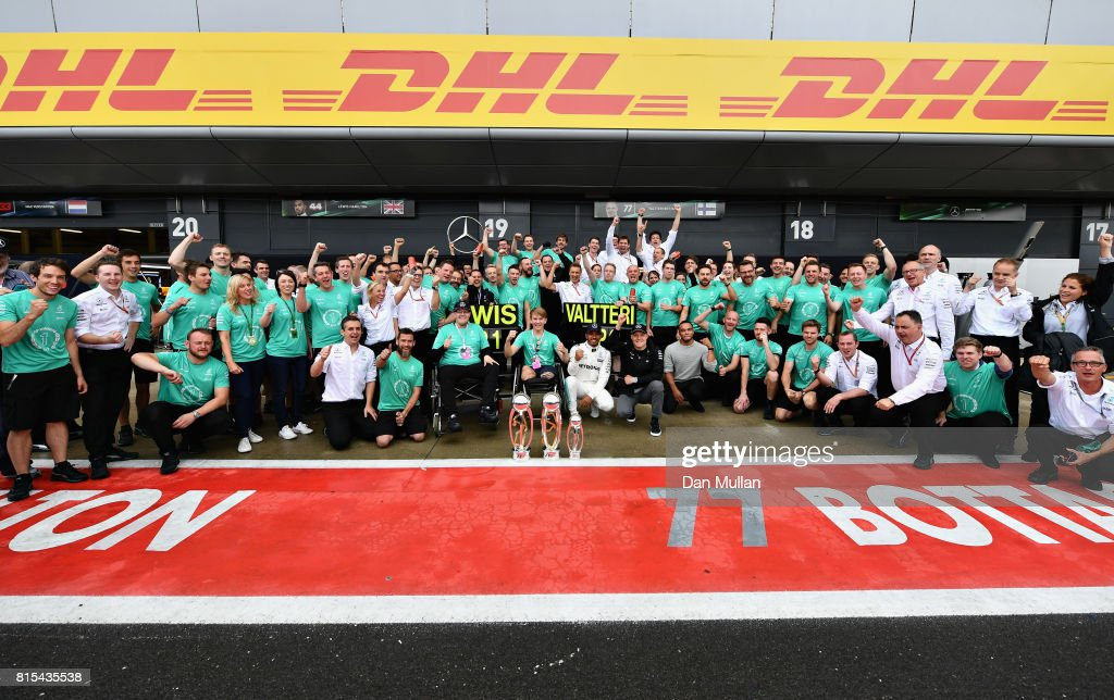 Race winner Lewis Hamilton of Great Britain and Mercedes GP celebrates with Valtteri Bottas of Finland and Mercedes GP, Billy Monger and his team after the Formula One Grand Prix of Great Britain at Silverstone on July 16, 2017 in Northampton, England.