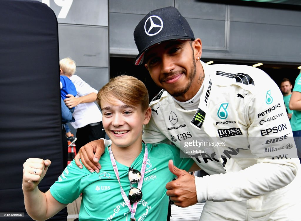 Race winner Lewis Hamilton of Great Britain and Mercedes GP celebrates with Billy Monger after the Formula One Grand Prix of Great Britain at Silverstone on July 16, 2017 in Northampton, England.