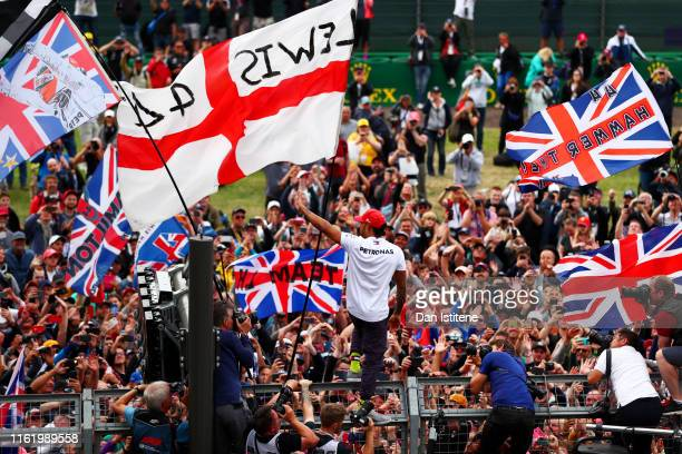 Race winner Lewis Hamilton of Great Britain and Mercedes GP celebrates with the fans after the F1 Grand Prix of Great Britain at Silverstone on July...