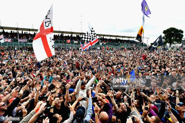 Race winner Lewis Hamilton of Great Britain and Mercedes GP celebrates with the fans after the Formula One Grand Prix of Great Britain at Silverstone...