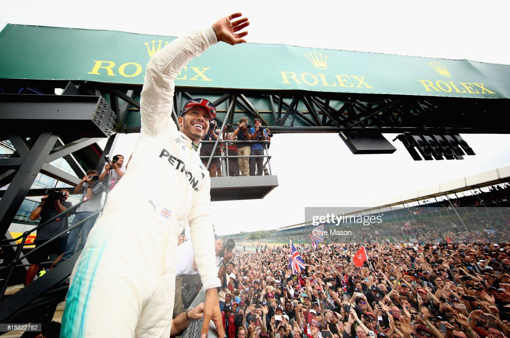 Race winner Lewis Hamilton of Great Britain and Mercedes GP celebrates with the fans after the Formula One Grand Prix of Great Britain at Silverstone on July 16, 2017 in Northampton, England.