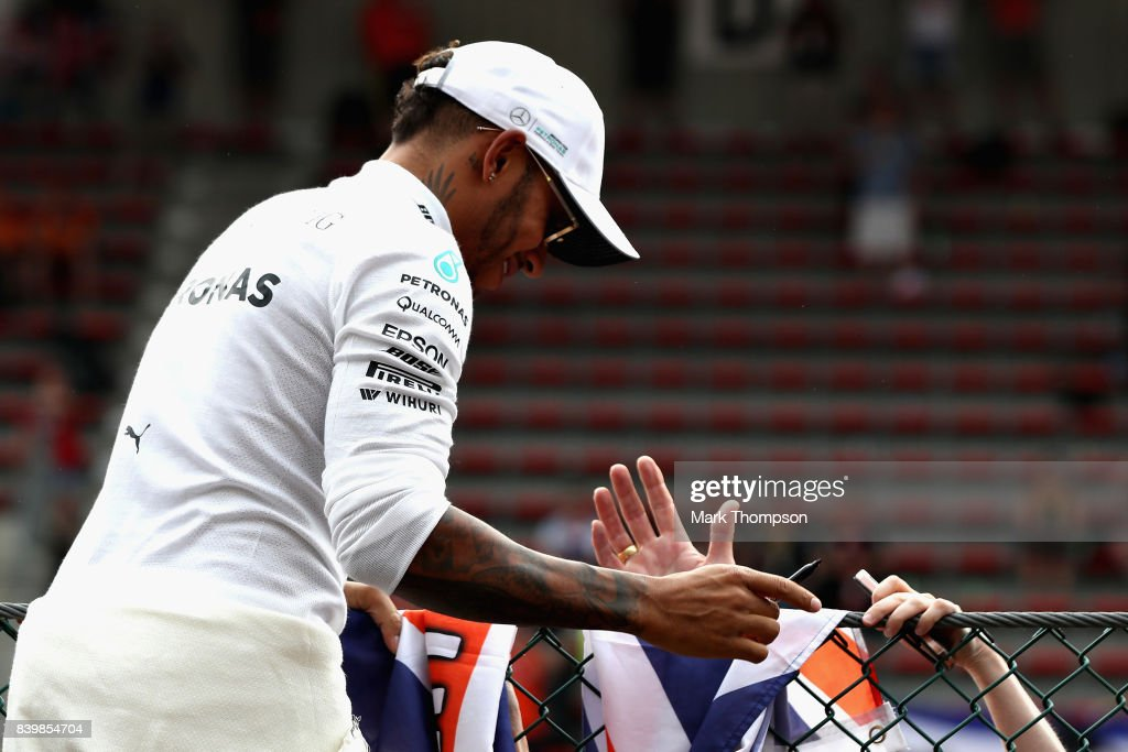 Race winner Lewis Hamilton of Great Britain and Mercedes GP celebrates with the crowd after the Formula One Grand Prix of Belgium at Circuit de Spa-Francorchamps on August 27, 2017 in Spa, Belgium.