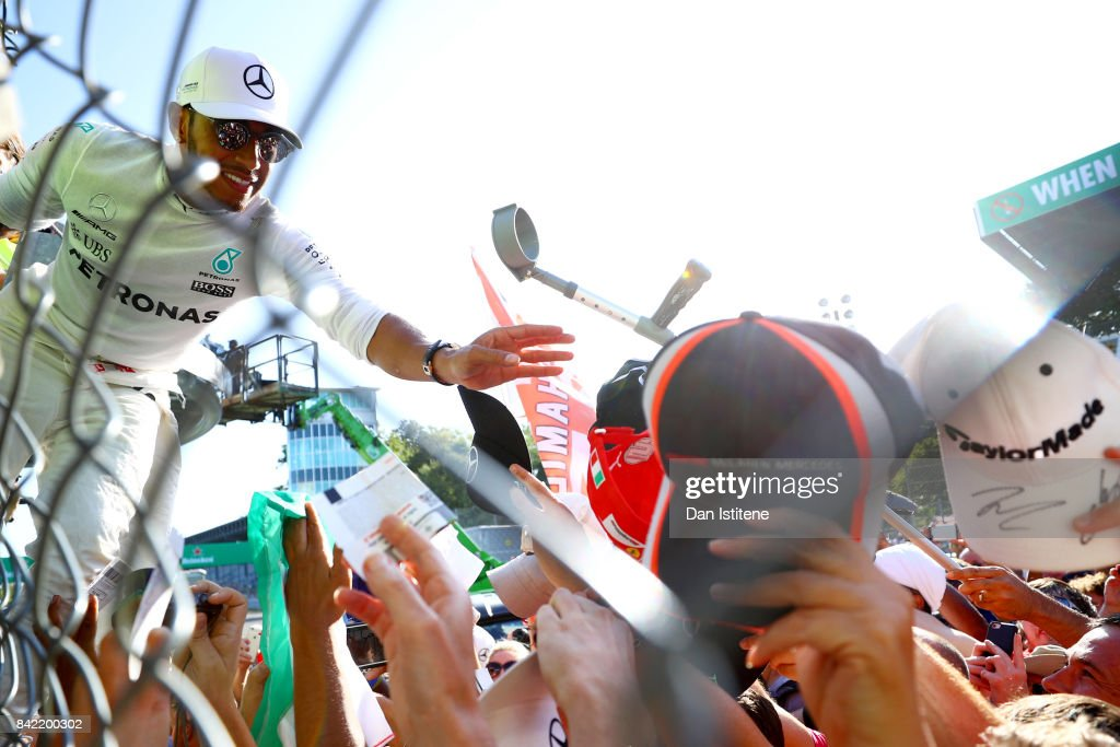 Race winner Lewis Hamilton of Great Britain and Mercedes GP celebrates with the fans after the Formula One Grand Prix of Italy at Autodromo di Monza on September 3, 2017 in Monza, Italy.