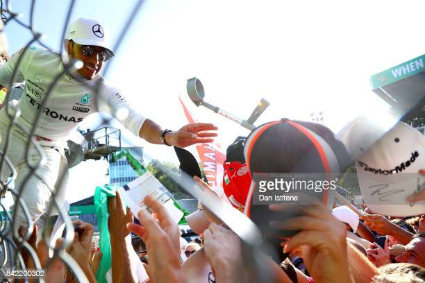 Race winner Lewis Hamilton of Great Britain and Mercedes GP celebrates with the fans after the Formula One Grand Prix of Italy at Autodromo di Monza...