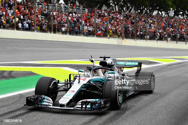 Race winner Lewis Hamilton of Great Britain driving the Mercedes AMG Petronas F1 Team Mercedes WO9 celebrates as he pulls into parc ferme during the...