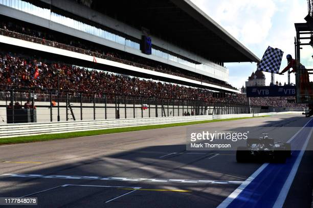 Race winner Lewis Hamilton of Great Britain driving the Mercedes AMG Petronas F1 Team Mercedes W10 takes the chequered flag during the F1 Grand Prix...