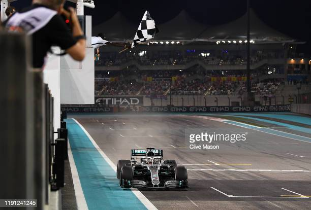 Race winner Lewis Hamilton of Great Britain driving the Mercedes AMG Petronas F1 Team Mercedes W10 takes the chequered flag at the end of the race...