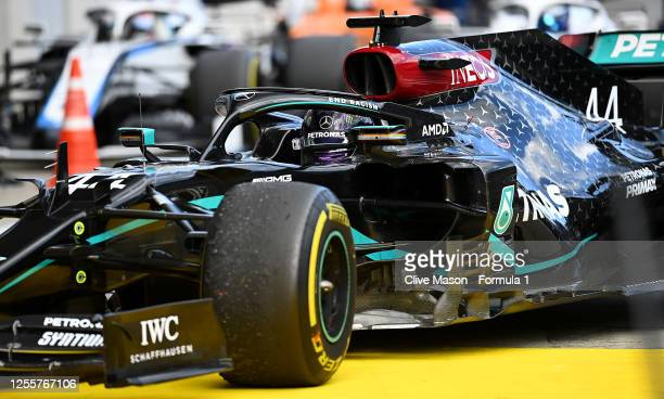 Race winner Lewis Hamilton of Great Britain driving the Mercedes AMG Petronas F1 Team Mercedes W11 pulls into parc ferme during the Formula One Grand...