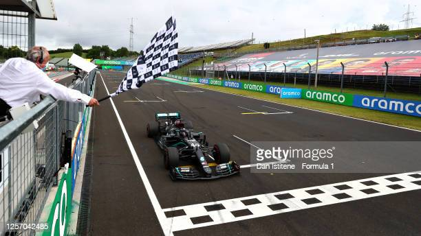 Race winner Lewis Hamilton of Great Britain driving the Mercedes AMG Petronas F1 Team Mercedes W11 takes the chequered flag during the Formula One...