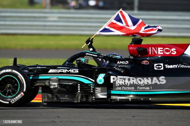 Race winner Lewis Hamilton of Great Britain driving the Mercedes AMG Petronas F1 Team Mercedes W12 waves the Union Jack to celebrate during the F1...