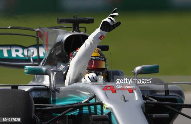 Race winner Lewis Hamilton of Great Britain driving the Mercedes AMG Petronas F1 Team Mercedes F1 WO8 celebrates on track during the Canadian Formula...