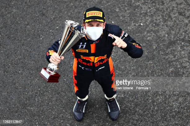 Race winner Liam Lawson of New Zealand and Hitech Grand Prix celebrates on the podium during race one of the Formula 3 Championship at Silverstone on...