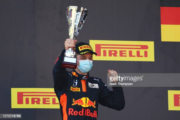 Race winner Liam Lawson of New Zealand and Hitech Grand Prix celebrates on the podium during the Formula 3 Championship Second Race at Mugello...