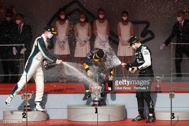 Race winner Liam Lawson of New Zealand and Hitech Grand Prix, second placed Dan Ticktum of Great Britain and Carlin and third placed Oscar Piastri of...