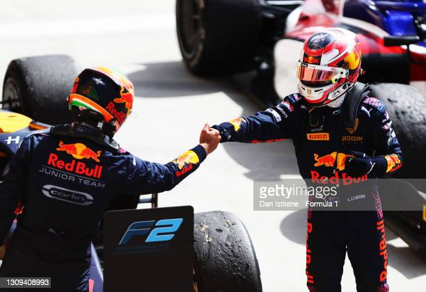Race winner, Liam Lawson of New Zealand and Hitech Grand Prix celebrates with second placed, Jehan Daruvala of India and Carlin in parc ferme during...